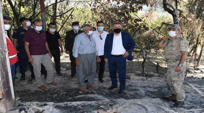 Adana Valisi Elban, Kozan'da orman yangınından etkilenen mahalleyi ziyaret etti