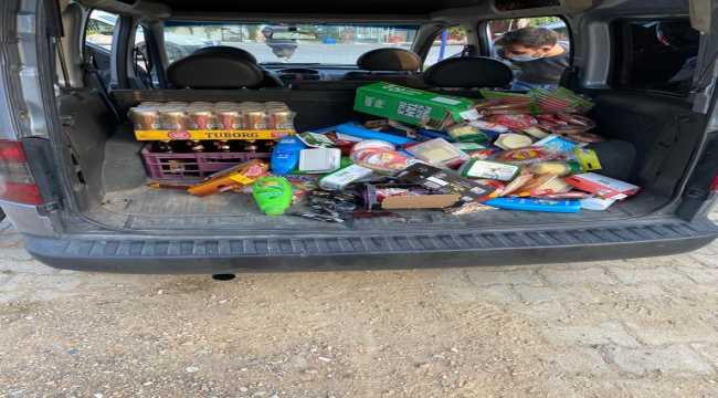 Isparta'da marketten hırsızlık yaptığı öne sürülen iki zanlı tutuklandı