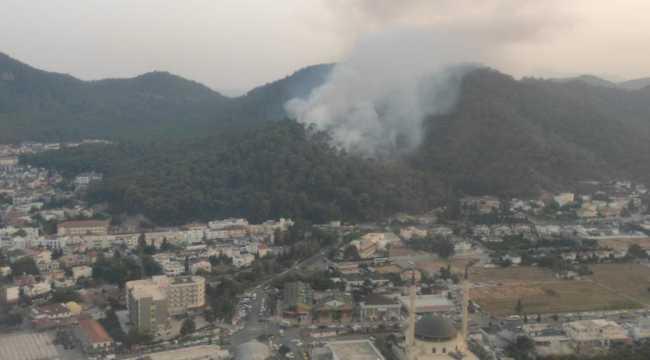 Antalya'da çıkan orman yangını yerleşim yerlerine ulaşmadan söndürüldü