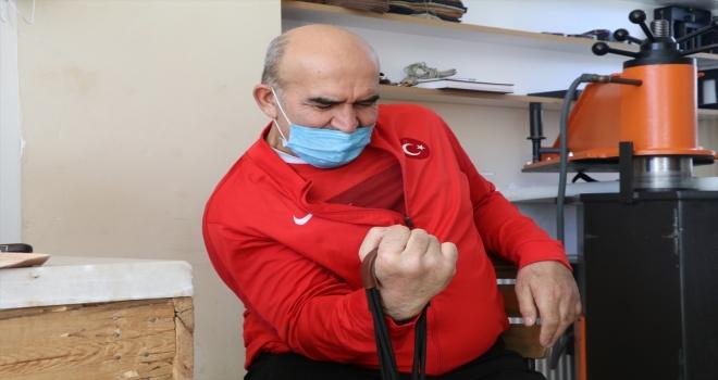 Bedensel engelli milli bilek güreşi sporcusu, mesleğinde engel tanımıyor